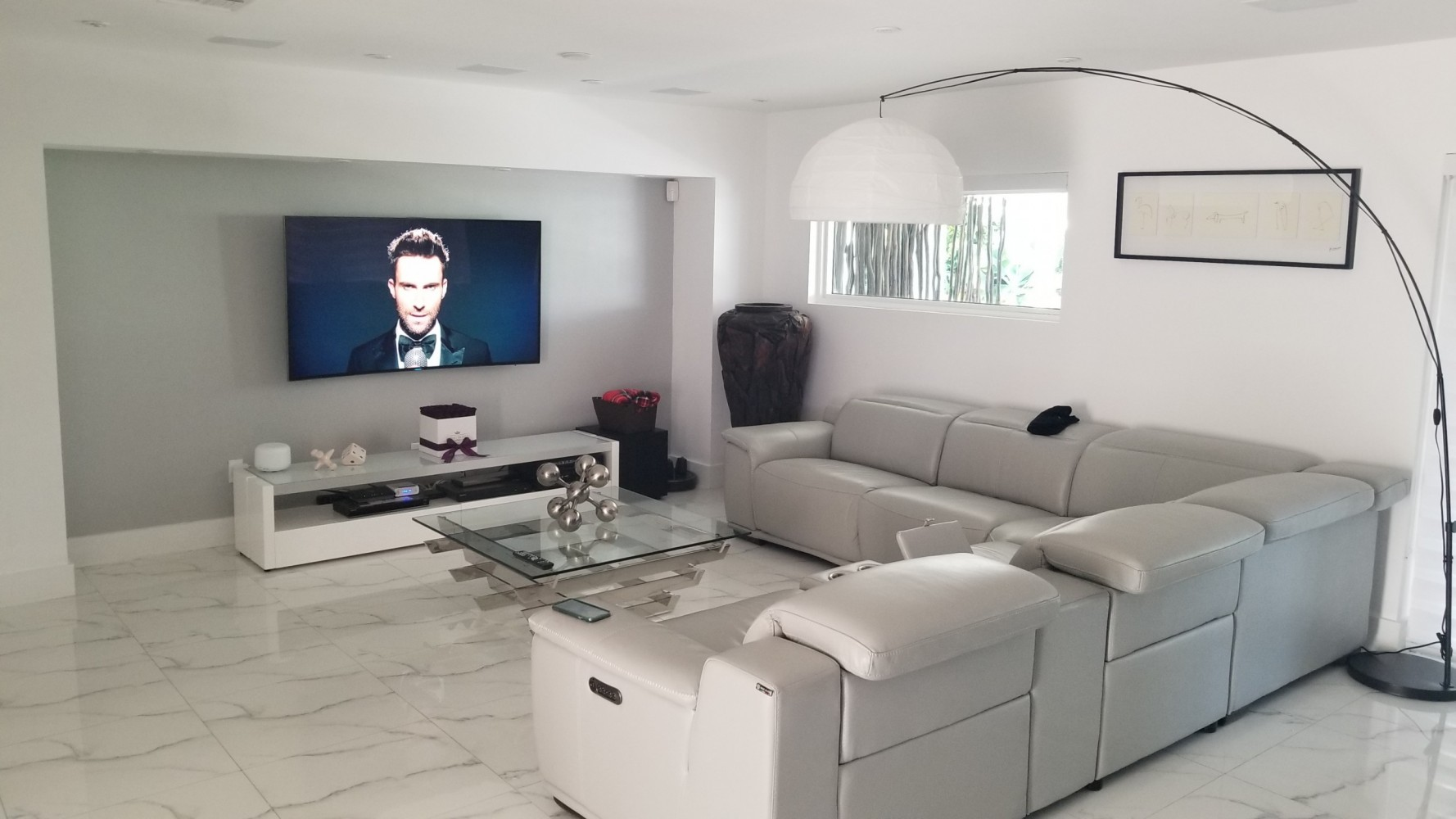 home theater with ceiling mounted surround sound speakers and wall mounted tv